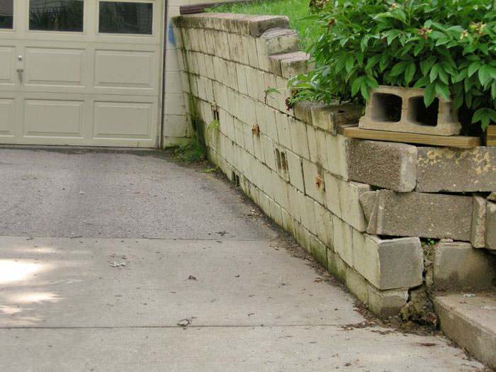 A Failing Retaining Wall Around Driveway In Duluth