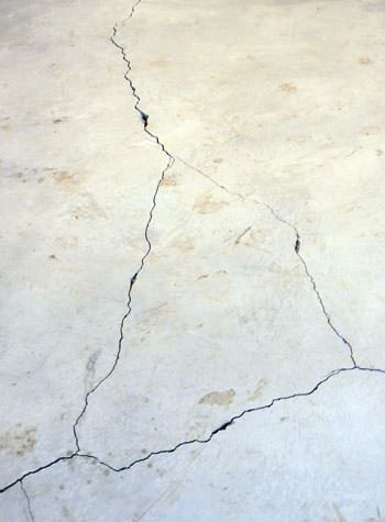 severely cracked, heaving slab floors in a home in Hayward