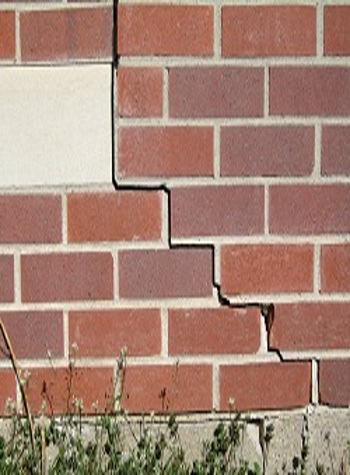 photo of a rotating foundation wall with cracks in Zimmerman