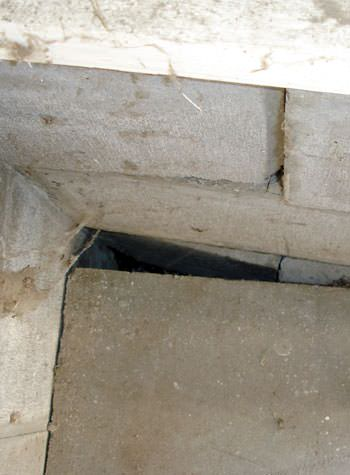 inward rotation of a foundation wall damaged by street creep in a garage in Virginia