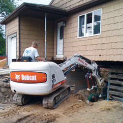 Excavating to expose the foundation walls and footings for a replacement job in Hibbing